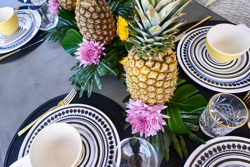 Pineapple centerpiece, budget-friendly centerpiece, tropical table set up
