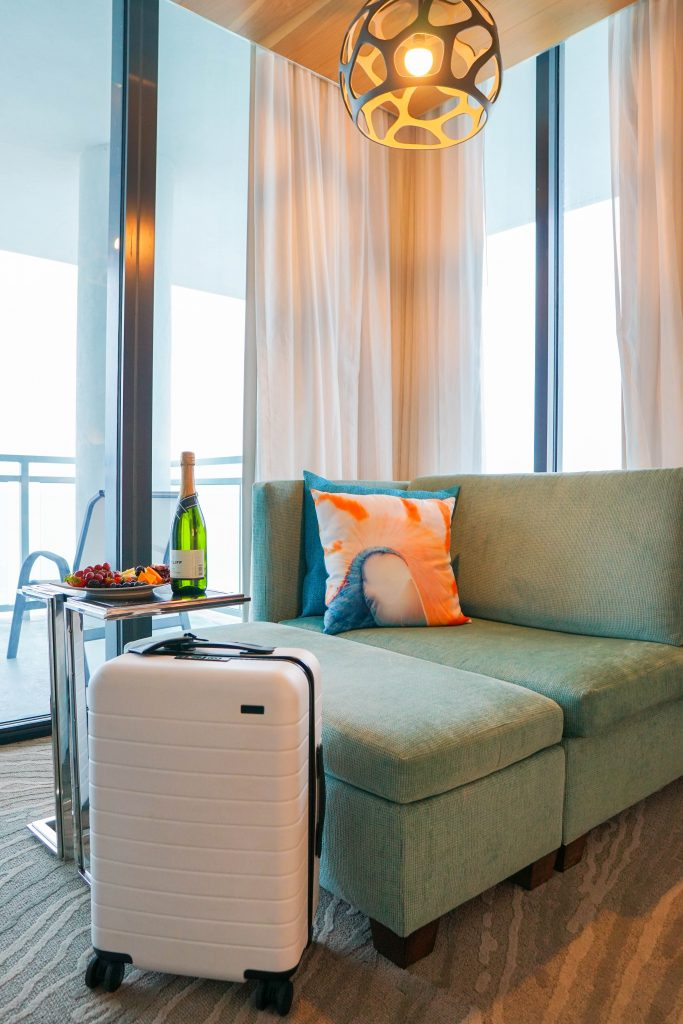 Away Bigger Carry On Suitcase in Hotel Room - How to save thousands on travel