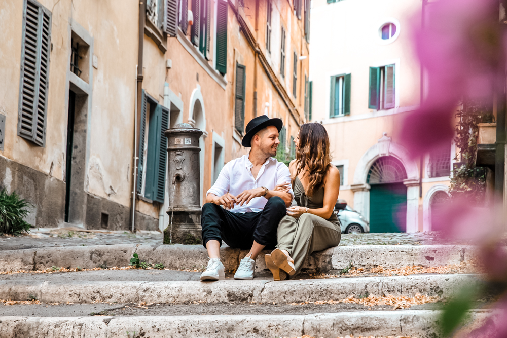 Photo captured by Guido in Rome for Flytographer // couple sitting on steps in Rome // 2 days in Rome travel guide